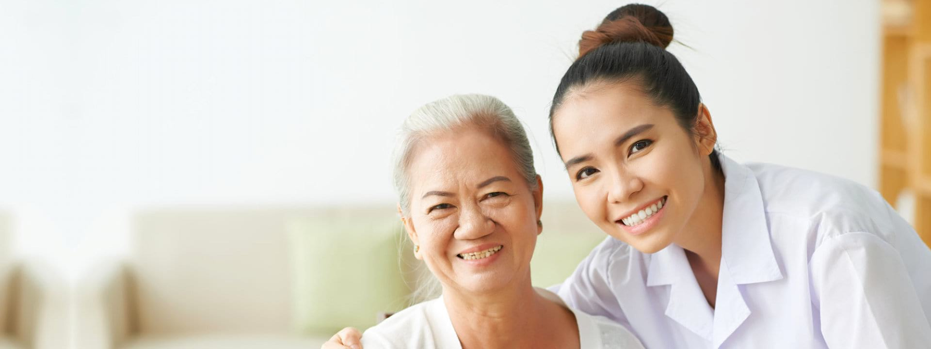 portrait of young woman and senior woman smiling