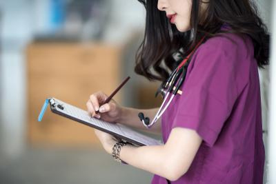 Nurse in purple uniform