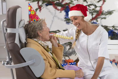 Caregiver and her patient celebrating Christmas Party