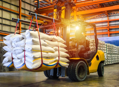 Forklift handling sugar bag for stuffing into container for export